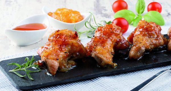 muslitos de pollo cocinados al horno con naranja y miel